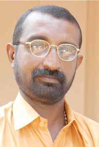 Dr. M. Kurian Thomas 1